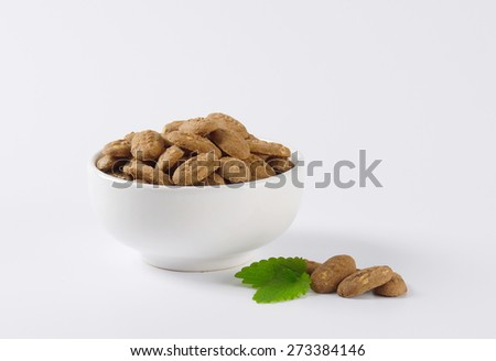 chocolate mini cookies in the bowl, decorated with piece of mint - stock photo