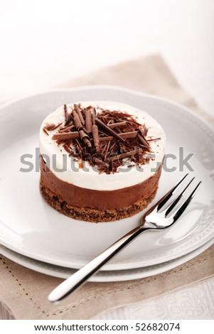 Chocolate moose dessert on a white plate - stock photo