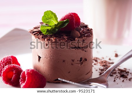 Chocolate Moose dessert on a white plate with milk