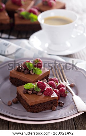 Chocolate mousse brownies with raspberry on a plate - stock photo