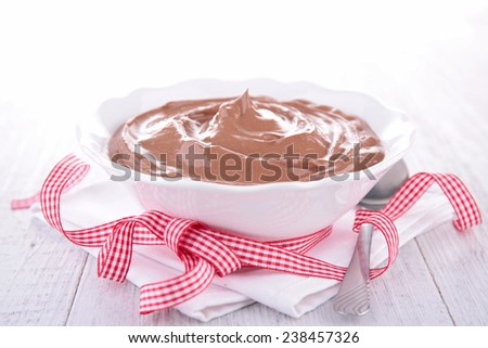 chocolate mousse in bowl and bow - stock photo