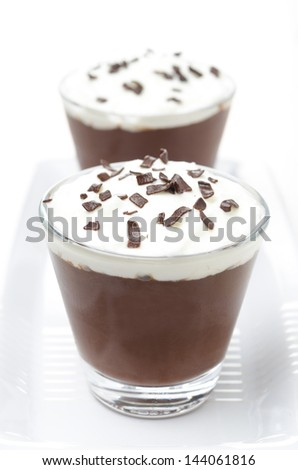 chocolate mousse with whipped cream on white background, close-up - stock photo