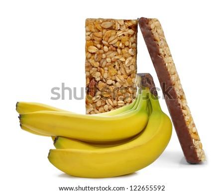 Chocolate Muesli Bars with bananas isolated on white background - stock photo