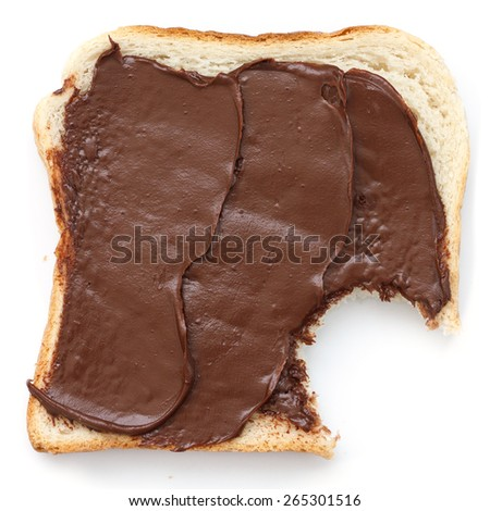 Chocolate nut spread on sliced white bread shot from above. - stock photo