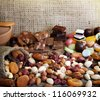 Chocolate nuts dried fruits and candy background - stock photo