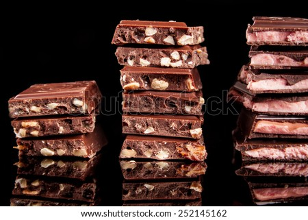 chocolate on a black background - stock photo