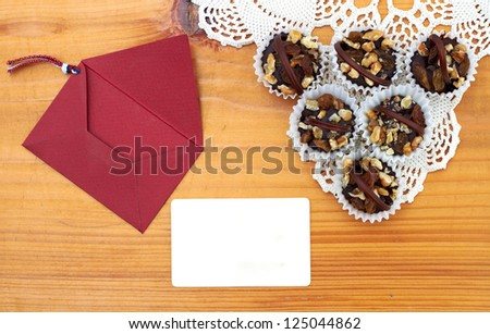Chocolate pastries  and message on a wooden table - stock photo