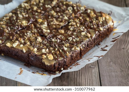 Chocolate pie with nuts and caramel for your design - stock photo