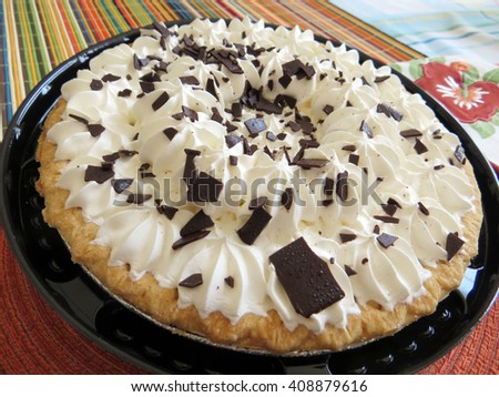Chocolate pie  with whipped cream topping and chocolate shavings - stock photo