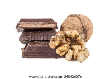 Chocolate pieces and walnuts isolated on white background with clipping path - stock photo