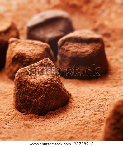 Chocolate pieces of irregular sizes covered in cocoa powder - stock photo