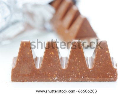 Chocolate pieces on white - stock photo