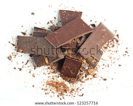 chocolate pieces with nuts on white background top view