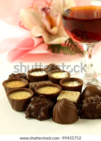Chocolate pralines and red wine for a dessert - stock photo