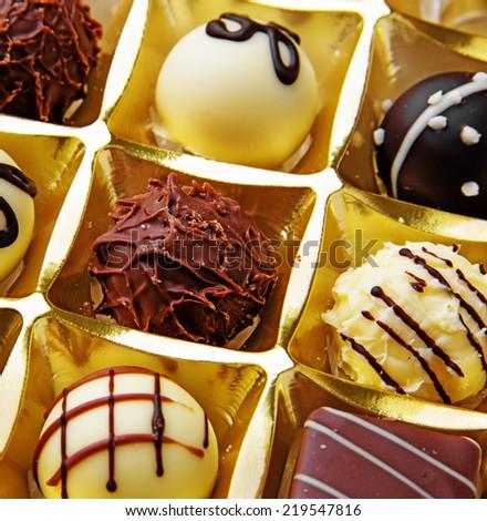 chocolate pralines - detail close up - stock photo