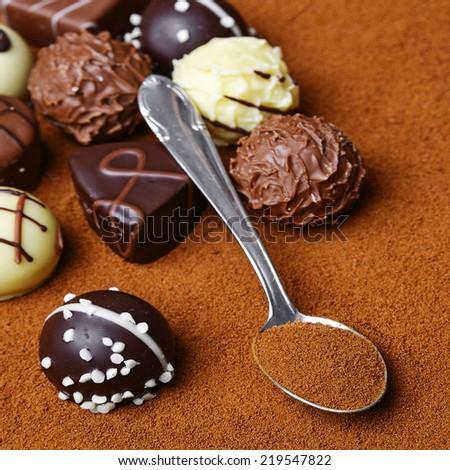 chocolate pralines on chocolate background - stock photo