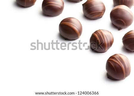 chocolate pralines on white background