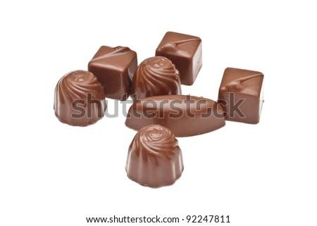 Chocolate pralines on white background - stock photo