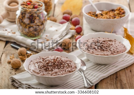 Chocolate pudding and baked granola, delicious start of day in the cool autumn