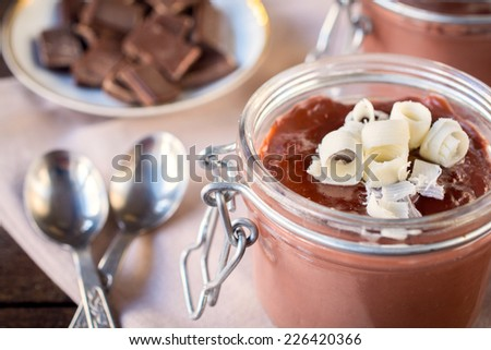 Chocolate pudding in the jar,selective focus  - stock photo