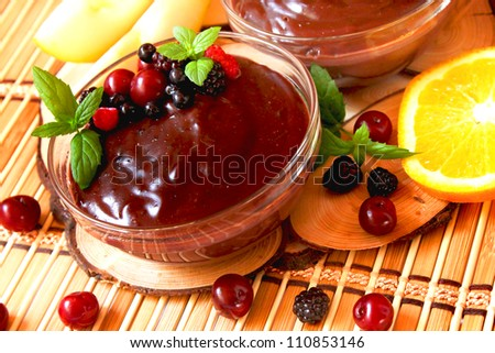 Chocolate pudding with berries and mint - stock photo