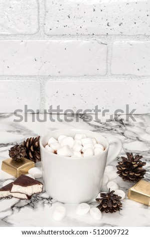 Chocolate pudding with marshmallows and candy souffle on a marble background