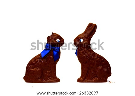Chocolate rabbits with ears and tail bitten off, isolated on white - stock photo