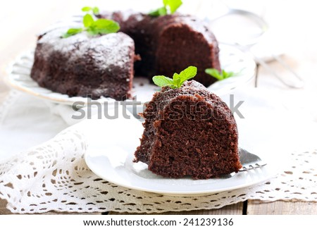Chocolate ring cake with icing sugar - stock photo