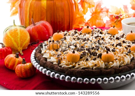 Chocolate salted caramel pumpkin cream pie for Thanksgiving. - stock photo