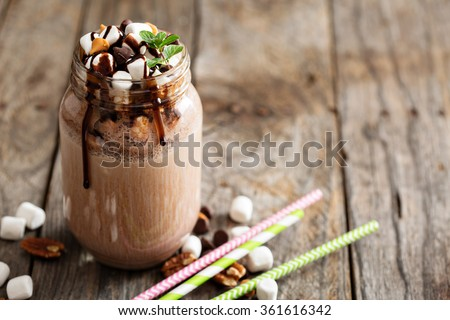 Chocolate shake with dripping sauce and marshmallows - stock photo