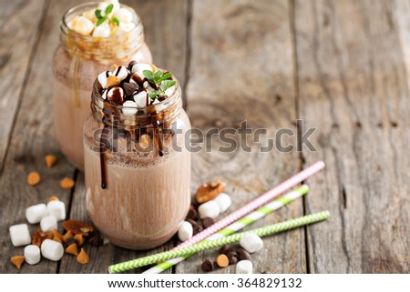 Chocolate shake with dripping sauce and marshmellows - stock photo