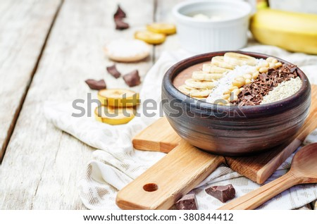 chocolate smoothie with banana, coconut, pine nuts, chocolate and sesame seeds. toning. selective focus - stock photo