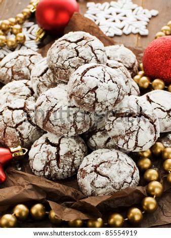 Chocolate snow cap cookies for Christmas. Shallow dof. - stock photo