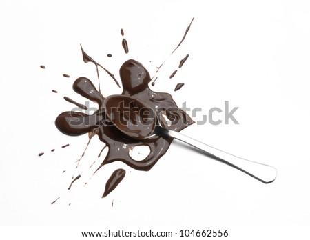 Chocolate spoon splash on white background. - stock photo