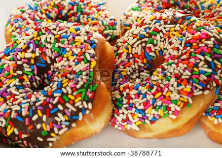 Chocolate sprinkle donuts - stock photo