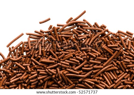 chocolate sprinkles on white background - stock photo