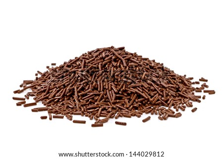 Chocolate sprinkles pile on white background - stock photo