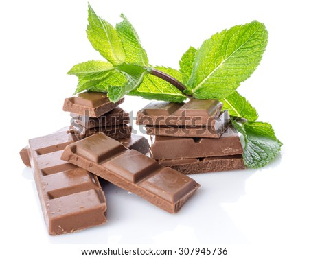 Chocolate squares with fresh mint, isolated on white