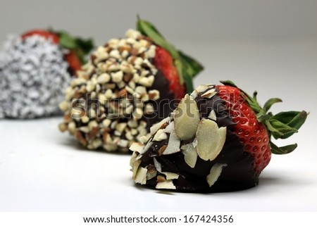 Chocolate Strawberries covered with nuts - stock photo