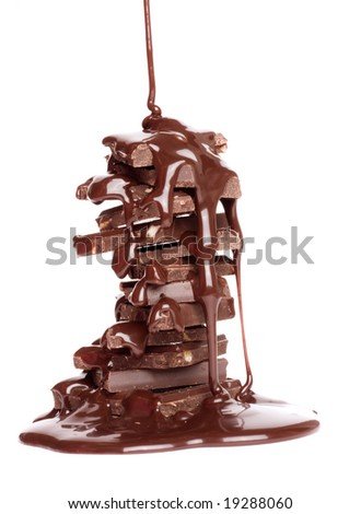 Chocolate syrup being poured over cake on white background - stock photo