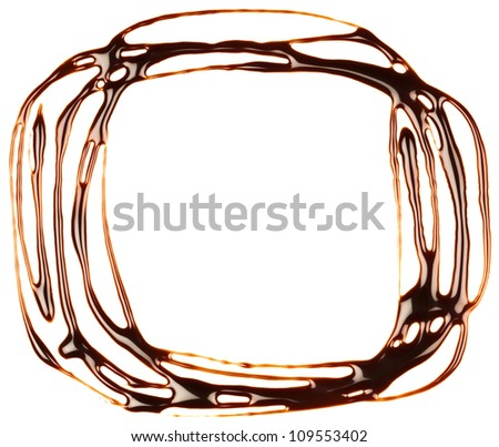 Chocolate syrup drip, frame is isolated on a white background - stock photo