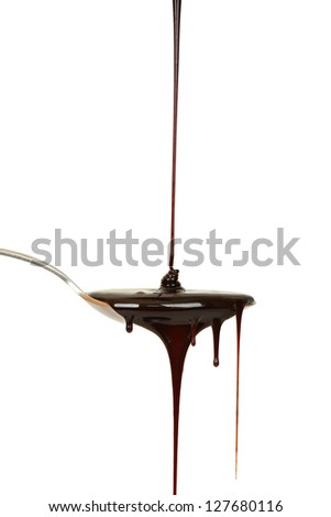 chocolate syrup dripping from spoon - stock photo
