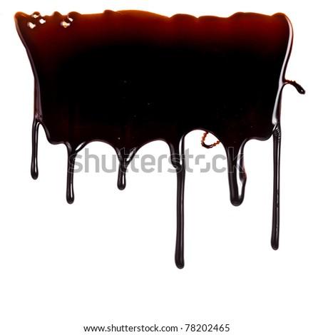 chocolate syrup leaking close up isolated on white background   - stock photo