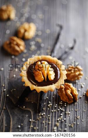 Chocolate tart with walnut - stock photo