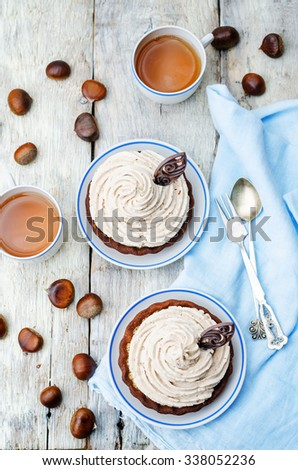 chocolate tartlet with chestnut cream frosting. toning. selective Focus - stock photo