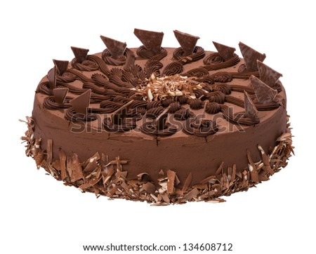 Chocolate torte - cake decorated with cream ruffles, isolated on white and with clipping path - stock photo