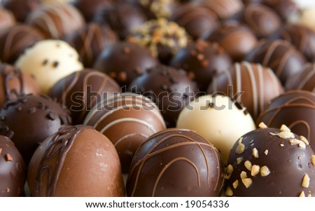 chocolate truffle candy background - focus only on front truffles - stock photo