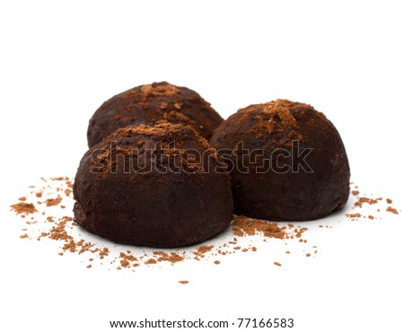 Chocolate truffle candy isolated on white background - stock photo