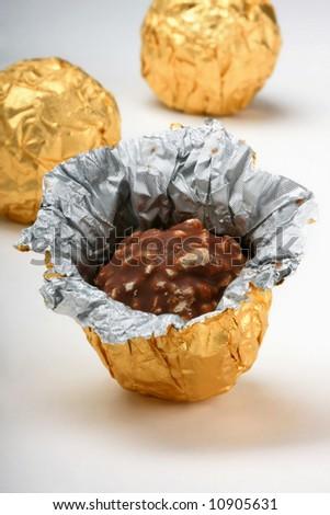 chocolate truffles foil wrap - stock photo