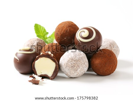 Chocolate truffles on white plate - stock photo